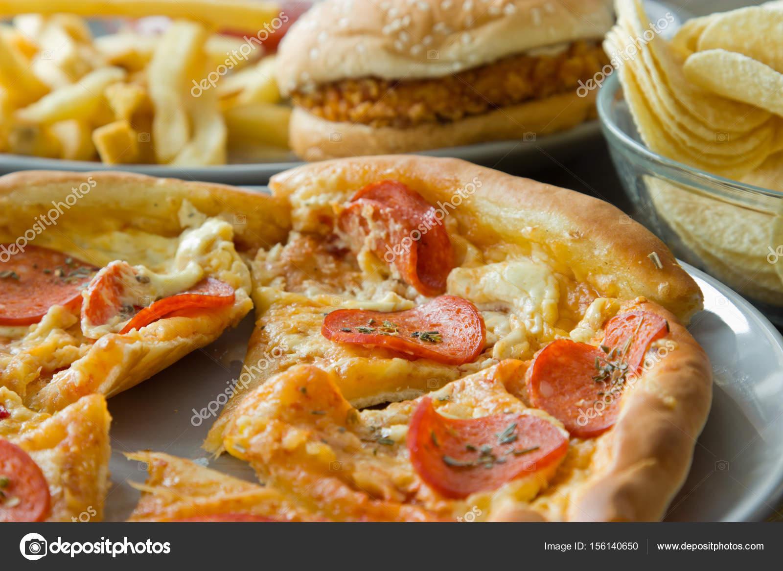 Unhealthy concept  unhealthy food: Burger, sauce, potatoes, pizz
