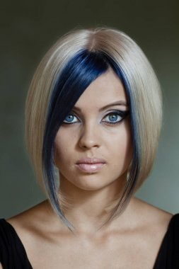 Beautiful blonde model with futuristic haircut