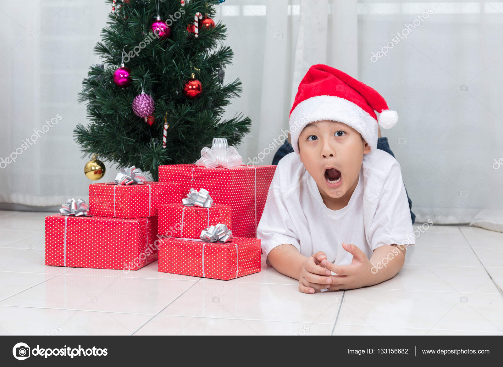 Asian Chinese little boy showing funny expression with Christmas ...