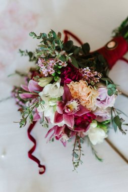 elegant wedding bouquet of fresh natural flowers and greenery