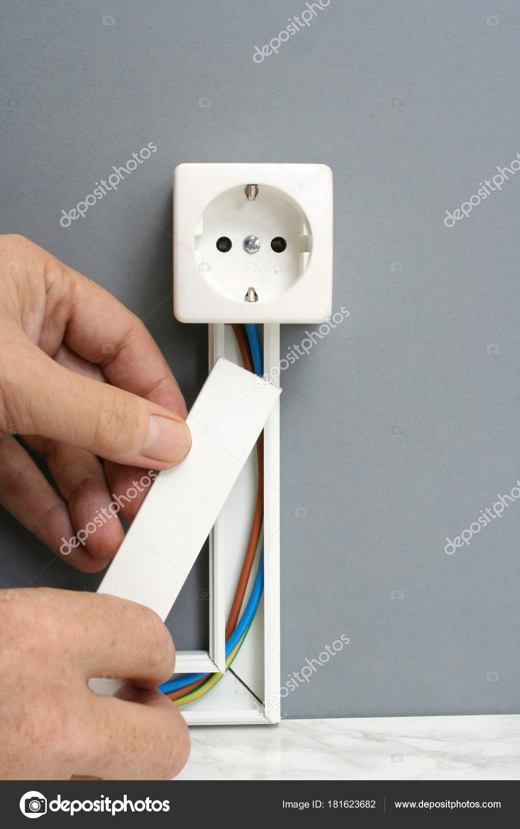 installing a power outlet with surface mount electric wiring cha rh depositphotos com