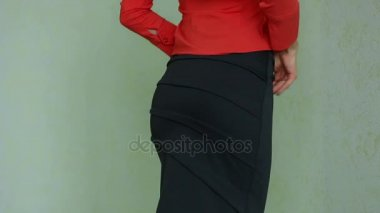 Girl takes off skirt