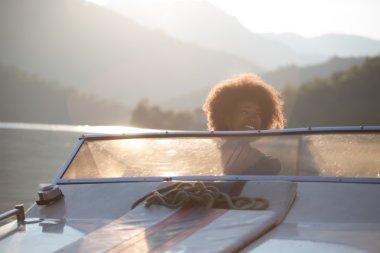 Beautiful girl enjoying boat ride
