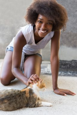 afro woman with cat