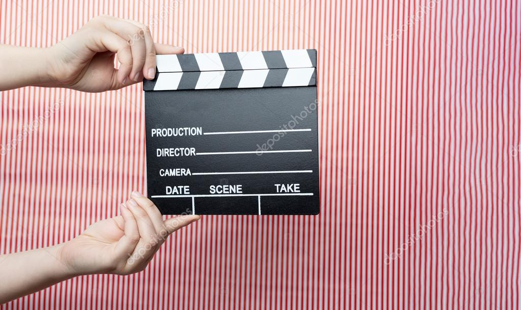 Woman holding movie clapper