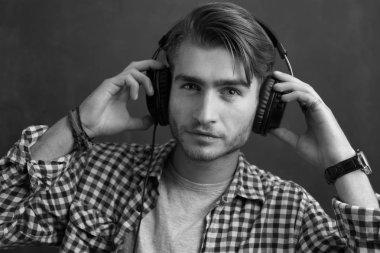 Portrait of confident young DJ