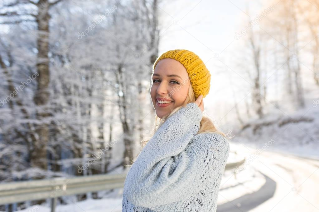 Winter portrait of a young smiling woman