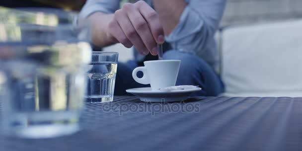 close-up of businessman drinking coffee in outdoor cafe