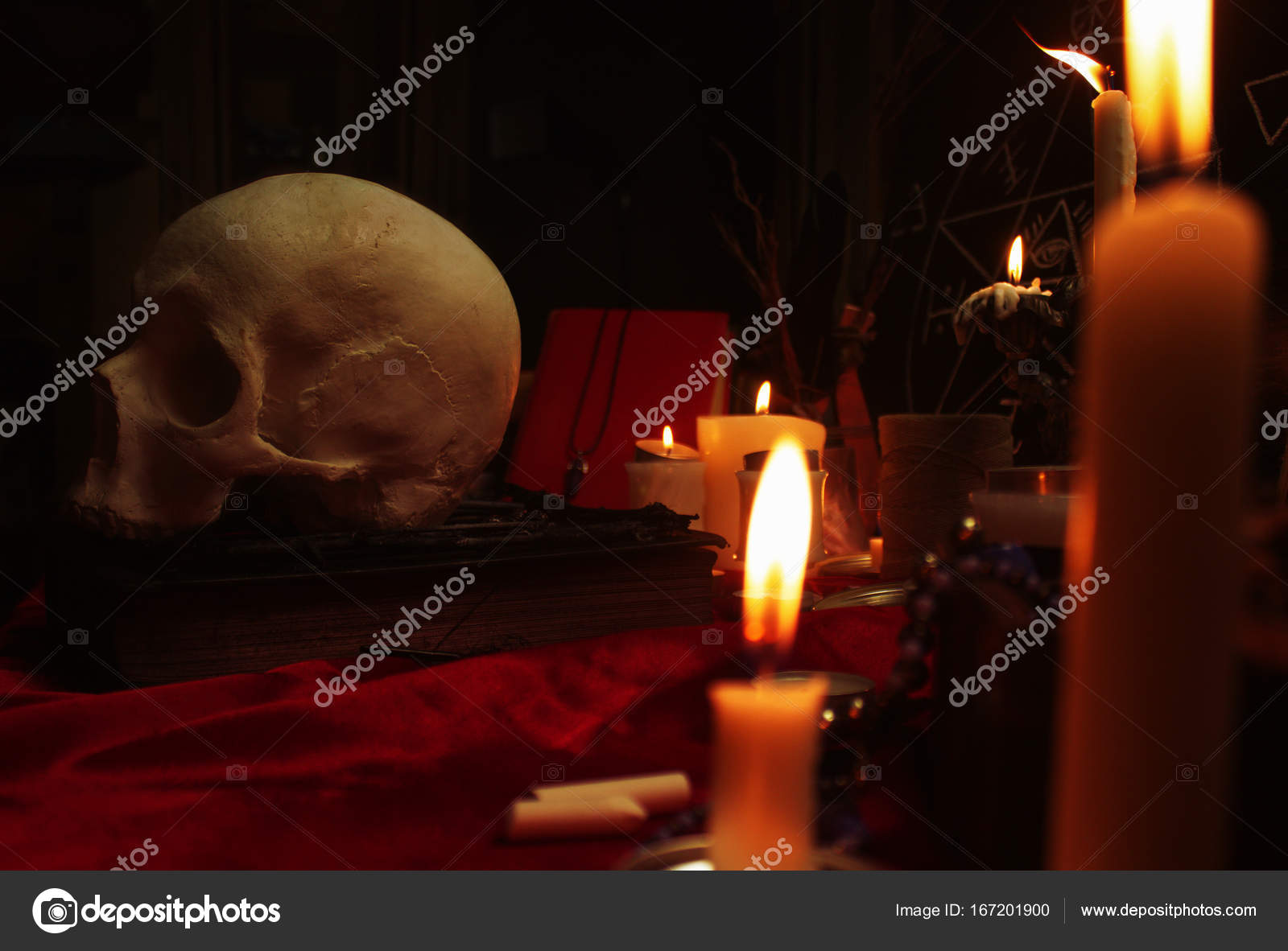 Human skull, candles, magic book and pentagram — Stock Photo
