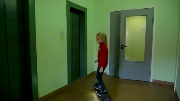 The girl goes in the house on a scooter in isolation covid19