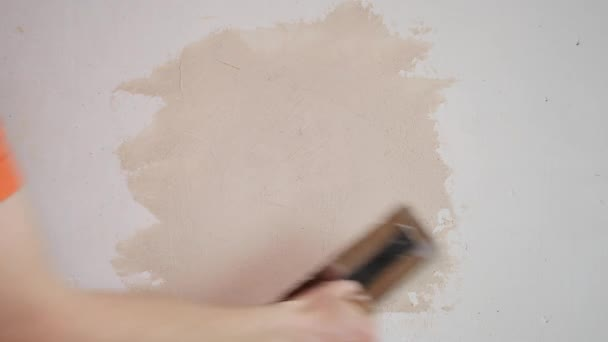 Worker Applies Plaster to the Wall With a Spatula