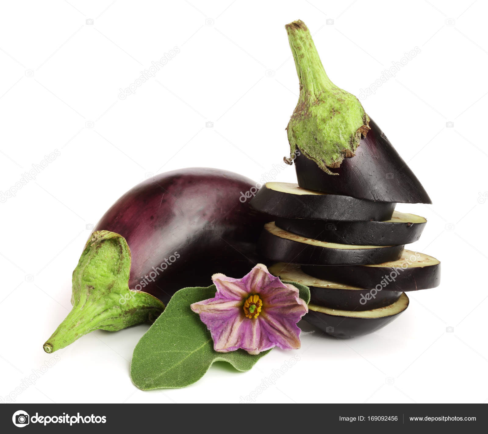Sliced Eggplant Or Aubergine Vegetable With Flower Isolated On White