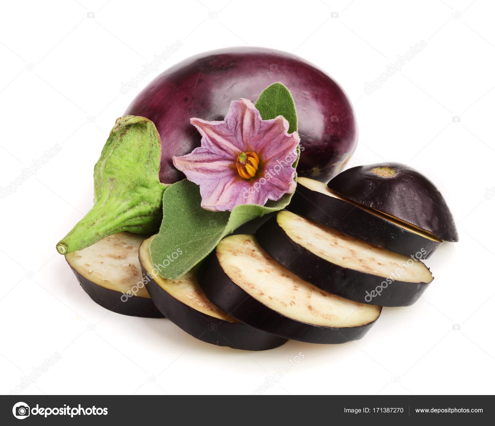 Sliced eggplant or aubergine vegetable with flower isolated on white sliced eggplant or aubergine vegetable with flower isolated on white background stock photo mightylinksfo