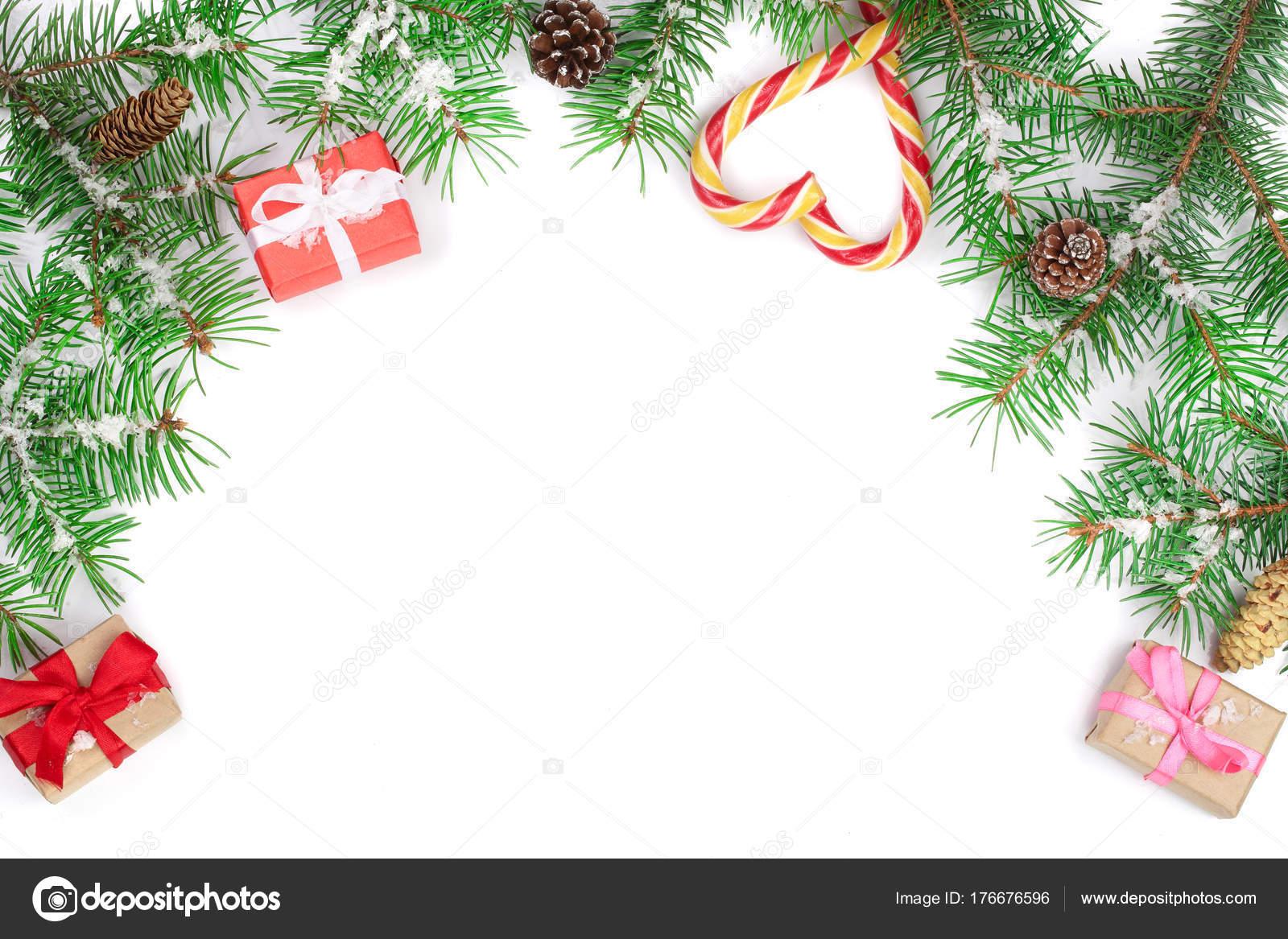 Weihnachten Rahmen der Tanne Zweig mit Zuckerstangen und isoliert ...