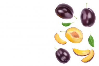 fresh purple plum and half with leaves isolated on white background with clipping path and copy spase for your text. Top view. Flat lay