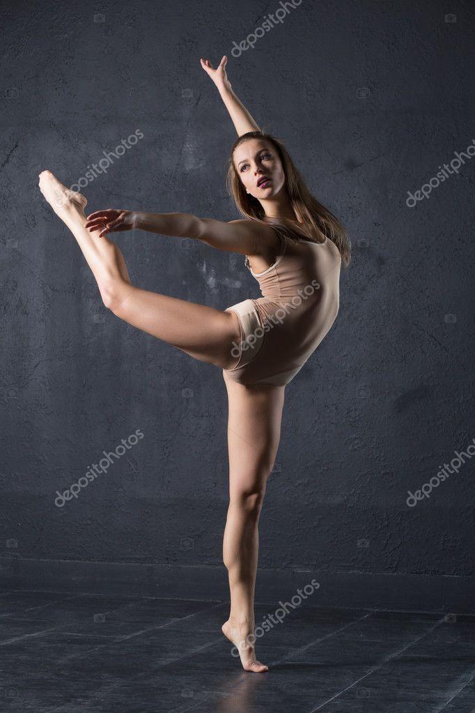 Elegant woman dance in dark studio