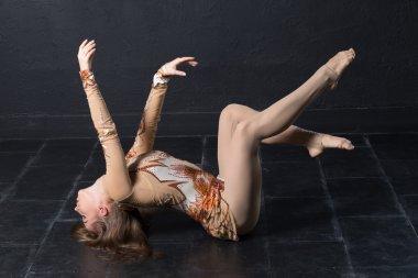 Woman dance posing unusually
