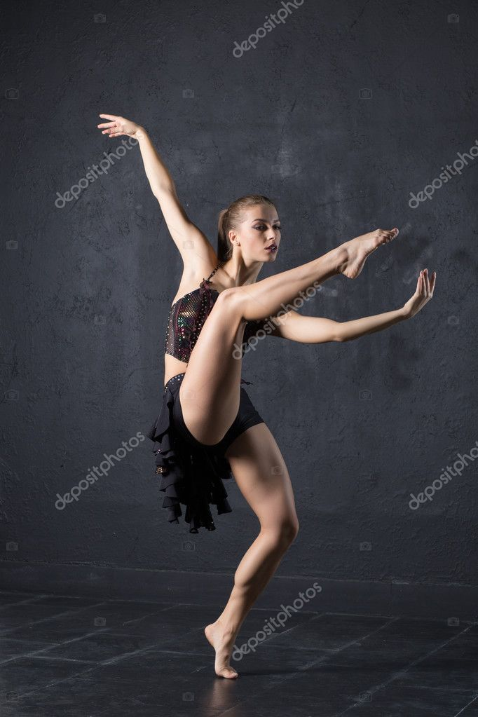 Woman dance against textured wall background