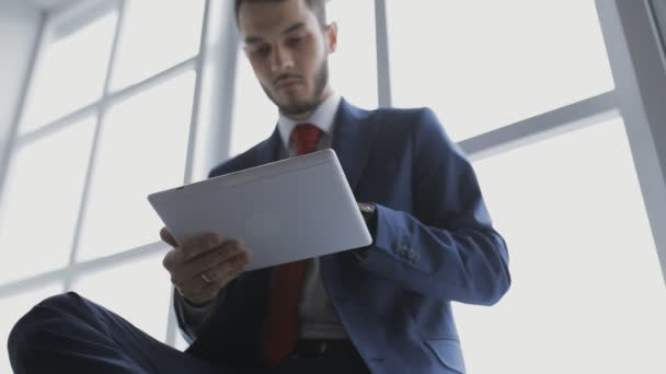 Young coworker businessman in office using digital tablet
