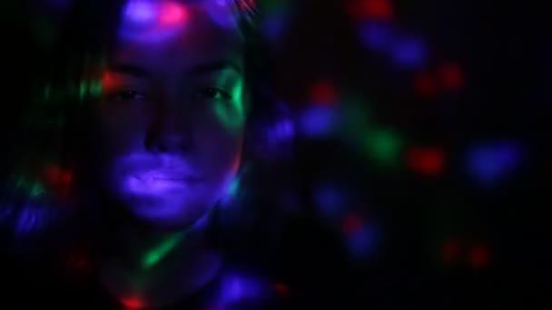 Disco light lamp shining on a girl