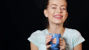 Teen girl drinking tea from empty cup