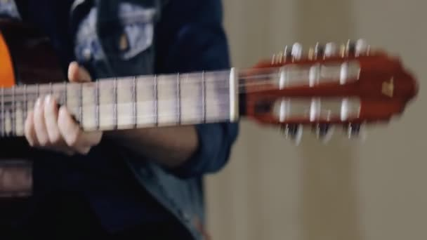 Guitarist tuning the acoustic guitar
