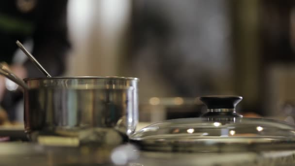 Abstract kitchen. Blurred background. Chef cooking close-up.