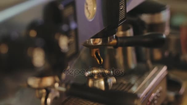 Closeup of barista working at coffee machine. Pour cacao in a cup.