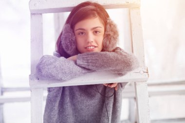 Teen girl enjoying music in fluffy headphones - toned photo
