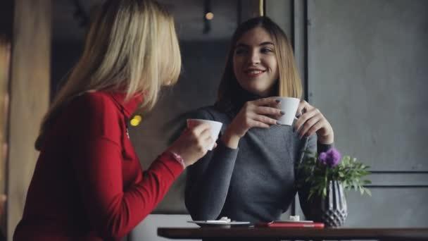Friends women having break in cafe, she drink coffee