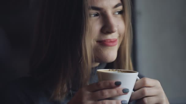 Woman drink coffee in cafe