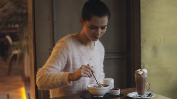 Woman eating healthy food in cafe