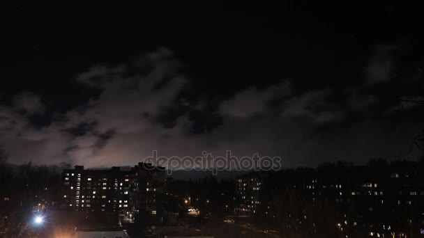 Timelapse of low bright night cloud, hurricane cityscape