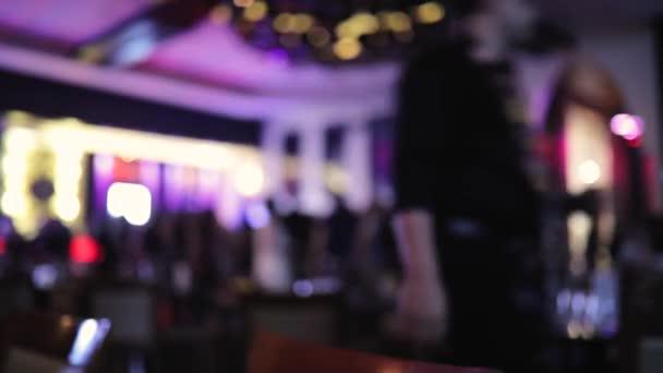 Night club background, people dancing, blurred