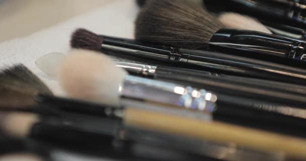 Set of cosmetic tool on table tool, beauty salon, take brush closeup