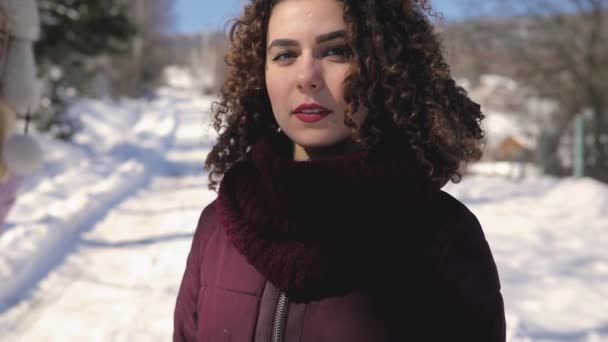 Cute Curly Hair Girl Make Kiss Outdoor At Snowy Day Stock Video