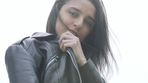 Fashion woman in black leather jacket
