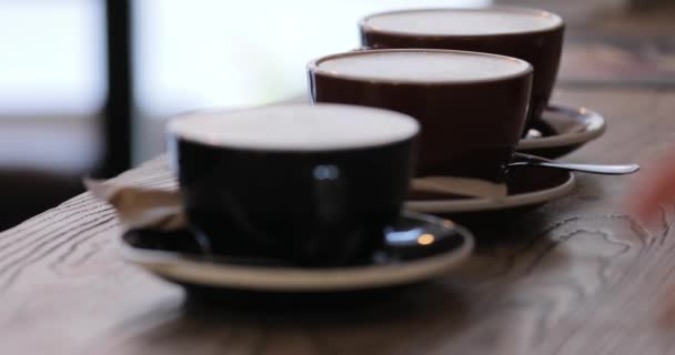 Ready latte cups on a table in cafe