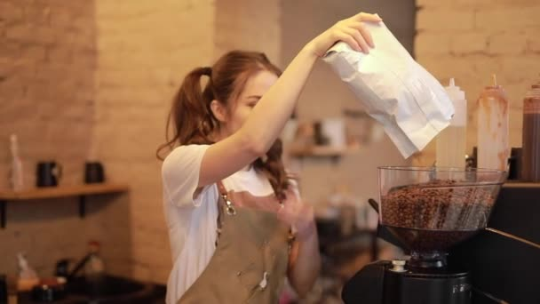 Young and cheerful barista woman make a coffee