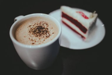 Cappuccino Coffee and Red Velvet Cake with Vintage Film Look