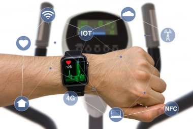Smart Watch Monitoring Heart Rate Application Concept While Exercising with Elliptical Machine