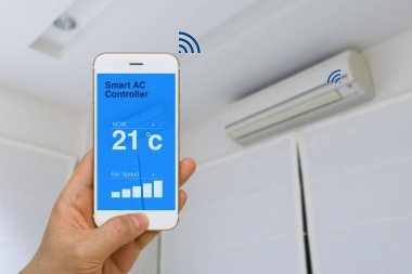 IOT Concept, Remotely Controlling Smart Air Conditioner with App on Smartphone