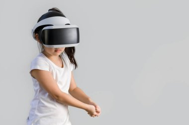 Kid with Virtual Reality, VR, Headset Studio Shot Isolated on White Background. Child Exploring Digital Virtual World with VR Goggles.