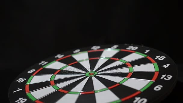 Arrows fly at the target game Darts