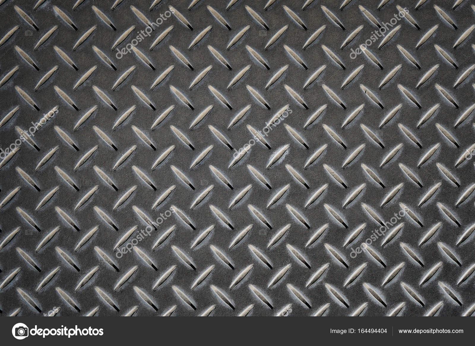 Deslizamiento chapa gris con rombos fotos de stock for Chapa antideslizante