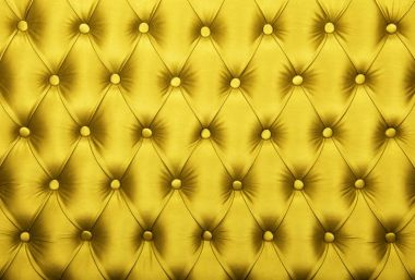 Yellow capitone tufted fabric upholstery texture