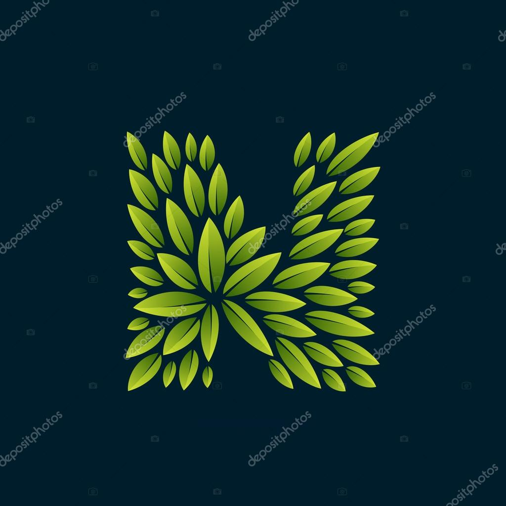 N letter logo formed by fresh green leaves.