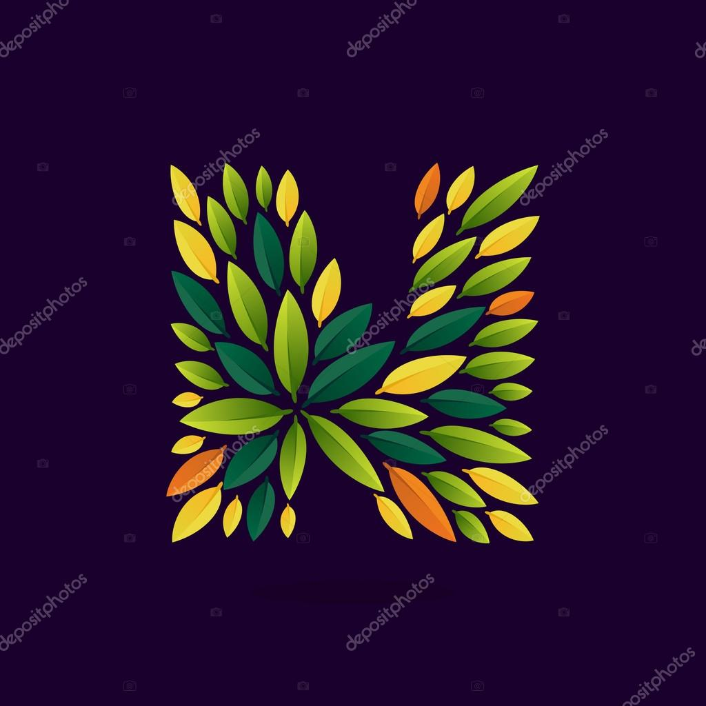 N letter logo formed by green and autumn leaves.