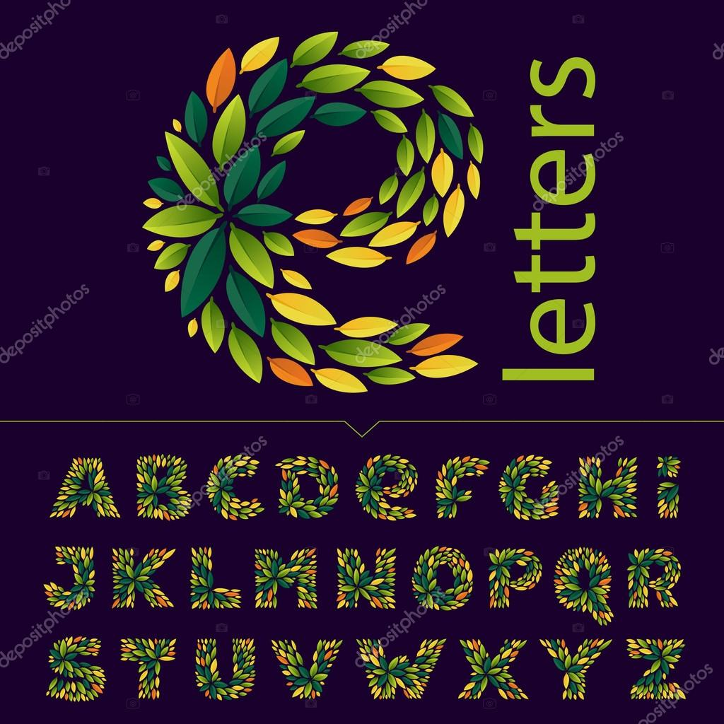 Alphabet logos formed by green and autumn leaves.