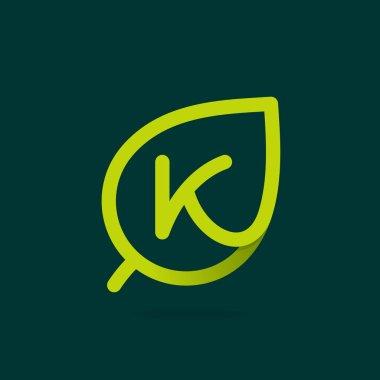 K letter logo in green leaf.